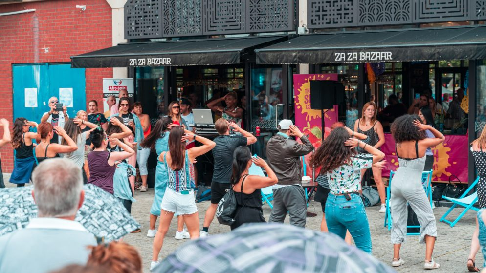 People dancing outside the restaurant at the Harbour Festival in Bristol, England